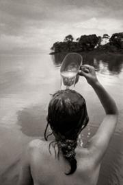 Black and white picture of a girl in a lake.